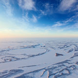 Short winter day above frozen tundra river, top view Stock Photography