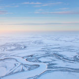 Short winter day above frozen tundra river, top view Royalty Free Stock Image