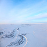 Short winter day above frozen tundra river, top view Stock Photos