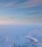 Short winter day above frozen tundra river, top view Stock Images