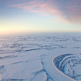 Short winter day above frozen tundra river, top view Stock Photo
