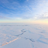 Short winter day above frozen tundra, top view Stock Images