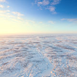 Short winter day above frozen tundra, top view Royalty Free Stock Image