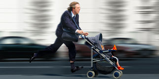 Shortage of time. Businessman with baby is to late royalty free stock photo