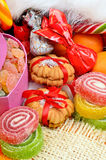 Shortbread biscuits, candies, jellies and tangerines. Stock Images