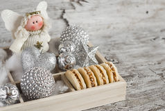 Shortbread biscuits with caramel cream and walnuts, Christmas decorations and Christmas angel in a wooden box. A homemade Christma Stock Images