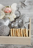 Shortbread biscuits with caramel cream and walnuts, Christmas decorations and Christmas angel in a wooden box. A homemade Christma Royalty Free Stock Photos