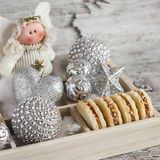 Shortbread biscuits with caramel cream and walnuts, Christmas decorations and Christmas angel in a wooden box. A homemade Christma Royalty Free Stock Image
