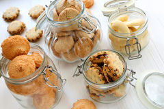 Shortbread biscuits in jars on a white wooden background Royalty Free Stock Images