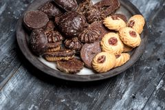 Shortbread butter cookies with chocolate and plum jam royalty free stock images