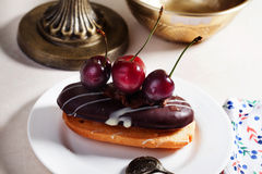 Shortbread cake with chocolate eclair a cherry Royalty Free Stock Photos