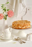 Shortbread cake with nuts and meringue on a stand Royalty Free Stock Photos