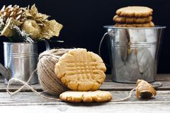 Shortbread cookie with peanut butter. On a black background Stock Photos