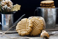 Shortbread cookie with peanut butter. On a black background Royalty Free Stock Image