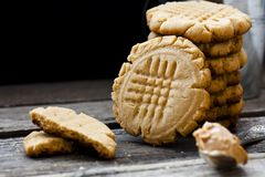 Shortbread cookie with peanut butter. On a black background Royalty Free Stock Images