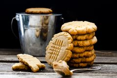 Shortbread cookie with peanut butter. On a black background Stock Photo