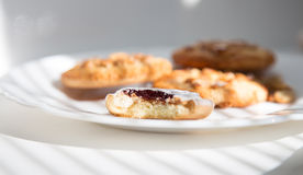 Shortbread cookie on a plate. Shortbread cookie with  sugar icing, jam stuffed on white plate Royalty Free Stock Images