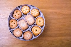 Shortbread cookie on the wooden table. Shortbread cookie in the round box on the wooden table Royalty Free Stock Images