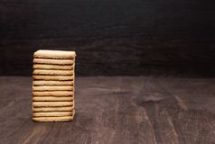 Shortbread cookie on a wooden table. Tower of cookies. Wooden background royalty free stock photos