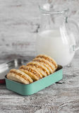 Shortbread cookies with caramel cream and walnuts in vintage metal box and a pitcher of milk Royalty Free Stock Image