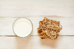 Shortbread cookies with cereals: sesame, seeds and milk. On a wh. Ite wooden background. Top view. Cooking concept. Concept of healthy food. Homemade Stock Photography