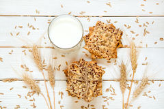 Shortbread cookies with cereals: sesame, seeds. On a white woode. N background. With cones and milk. Top view. Cooking concept. Concept of healthy food. Homemade Stock Photo