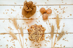 Shortbread cookies with cereals: sesame, seeds. On a white woode. N background. With cones, nuts and a little brown bag. Top view. Cooking concept. Concept of Stock Photography