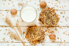Shortbread cookies with cereals: sesame, seeds. On a white woode. N background. With cones, nuts and milk  Top view. Cooking concept. Concept of healthy food Stock Images