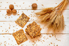 Shortbread cookies with cereals: sesame, seeds. On a white woode. N background. With cones and nuts. Top view. Cooking concept. Concept of healthy food. Homemade Stock Photography