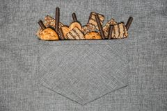 Cake confectionery glaze pastry sweet pocket apron gray. Shortbread cookies with chocolate coating and sweets against the gray apron in the pocket Stock Photography
