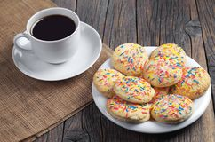 Cookies with colored sprinkles and coffee Royalty Free Stock Photos