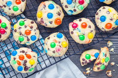 Shortbread cookies with multi-colored candy and chocolate chips on cooling rack, horizontal Royalty Free Stock Image