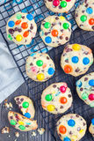 Shortbread cookies with multi-colored candy and chocolate chips on cooling rack, top view Royalty Free Stock Images