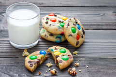 Shortbread cookies with multi-colored candy and chocolate chips, served with glass of milk, horizontal Stock Photography