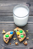 Shortbread cookies with multi-colored candy and chocolate chips, served with glass of milk Stock Images