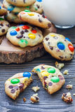 Shortbread cookies with multi-colored candy and chocolate chips on wooden board Stock Image