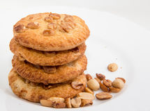 Shortbread cookies. With nuts and corn flakes icing on white plate background Stock Photo