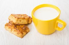 Shortbread cookies with peanuts and cup of milk Stock Photos