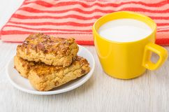 Shortbread cookies with peanuts in saucer, milk, red napkin Stock Photos