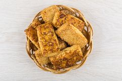 Shortbread cookies with peanuts and sesame in wicker basket Stock Image