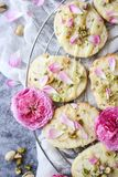 Shortbread cookies with pistachios and rose petals. Shortbread cookies made with pistachios, fresh rose petals and white chocolate stock photography