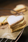 Shortbread cookies in shape of heart on a cooling rack Royalty Free Stock Photography