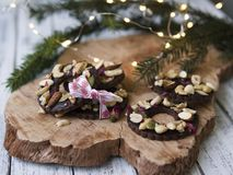 Shortbread cookies shaped as rings decorated with dried cherry and nuts. Christmas festive treat stock photography