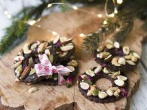 Shortbread cookies shaped as rings decorated with dried cherry and nuts. Christmas festive treat royalty free stock photography