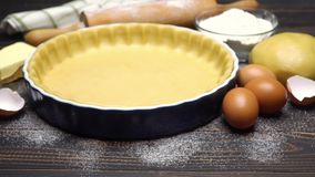 Shortbread dough for baking quiche tart and ingredients in baking form stock footage