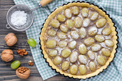 Shortbread dough grape tart with walnut praline, top view, horizontal Royalty Free Stock Image