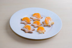 Shortbread glazed cookies with tangerines Royalty Free Stock Images