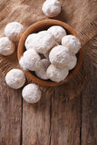 Shortbread polvoron in a wooden bowl. vertical top view Stock Images