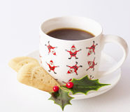 Shortbread with Sata Cup and Holly. Stock Image
