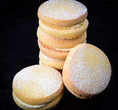 Shortbread stuffed with cream. Stack of shortbread stuffed with vanilla cream Stock Photo